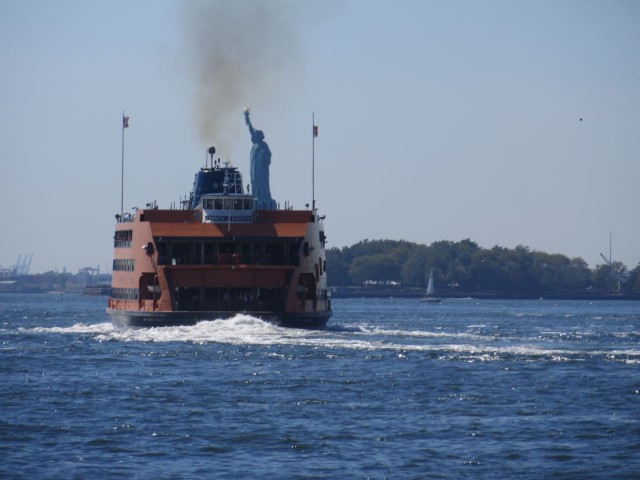 Couldn't resist this - Is that Lady Liberty hitching a ride on the orange Staten island Ferry??