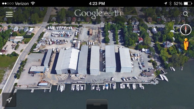 A Google Earth view of the Sunset Creek Boating Center. Smaller boats are stored in the huge gray buildings and are moved on big forklifts when someone wants to use them.