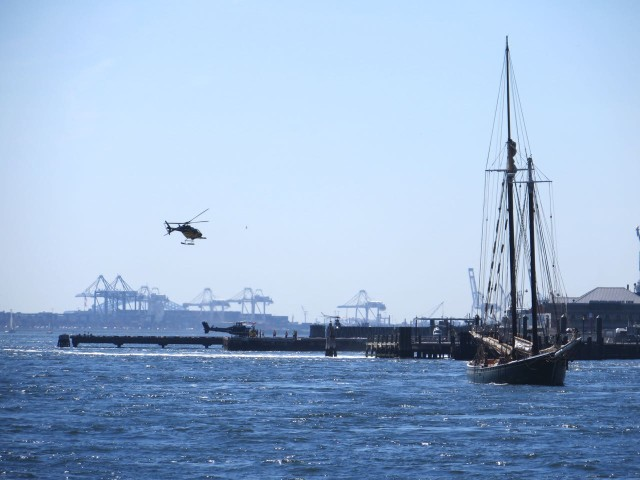 A little incongruous to see the helicopter and the old sailing vessel together.