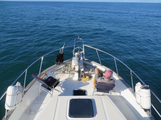 With autopilot and an open sea with nothing around for miles, we can both relax on the bow. What a great place that is ! And the interior helm controls are only steps away.