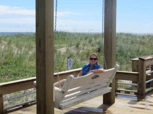 Enjoying the swing on the boardwalk.