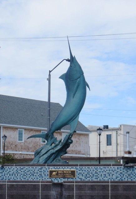 The blue marlin statue stands as a tribute to the town's fishing heritage.
