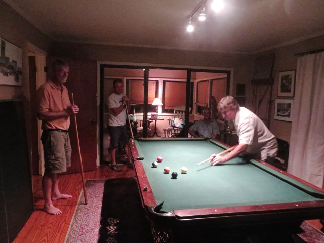 A game diverts the guys' conversations from boat talk to billiards.