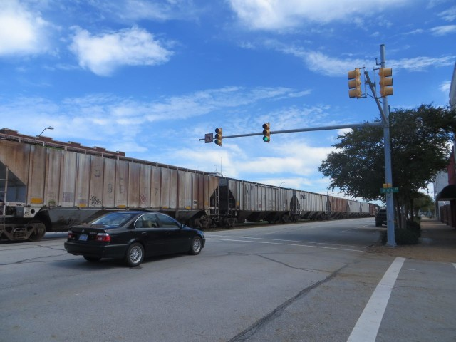Now this was a surprise to me - trains run right down the middle of the main street, between the two lanes of cars!