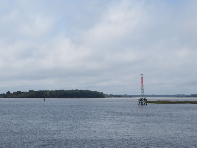 The final day of travel to Savannah was a short one and much less gray. The skies were finally brightening. This is the where the ICW enters the Savannah River.