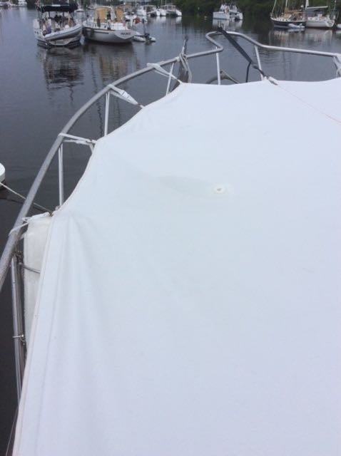 The sunshade over the bow of the boat. Water collected on it so it was necessary to add a hole for the water to drain before ether weight ripped the cover.