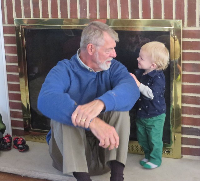Papa Al and Caleb (our New York grandson) have a chat by the fireplace.