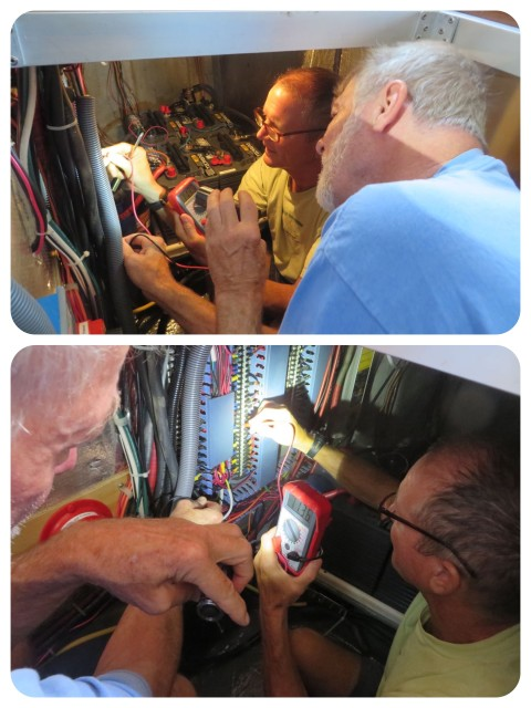 Dan and Al in the engine room solving an electrical problem. At least on a trawler they can both fit in the engine room.