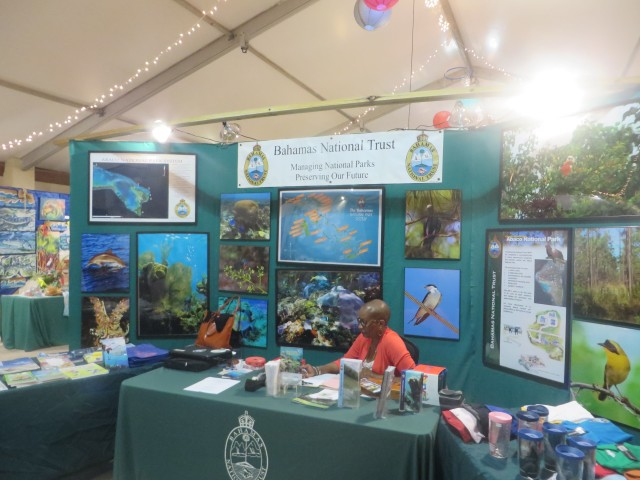 Entering the tent, you are greeted by the welcome table with information about the Bahama National Trust.