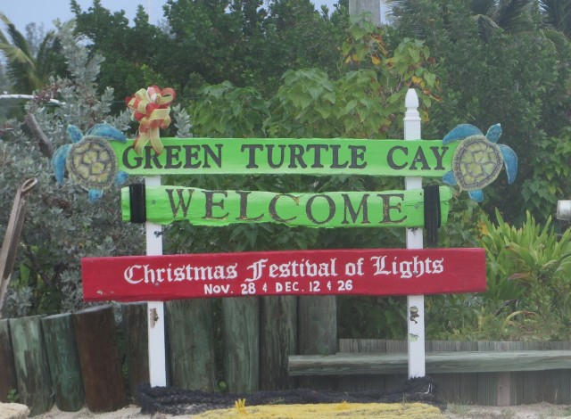 The colorful Green Turtle WELCOME sign also looks Christmasy with the red announcement of the Festival of Lights.