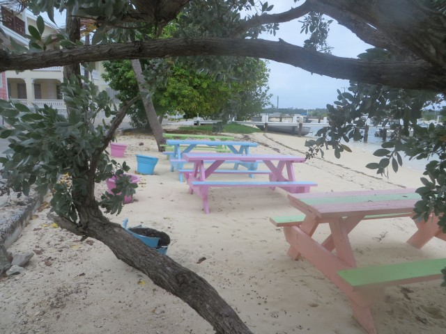 Love these pastel colored picnic tables outside of a little snack shop on the bay.