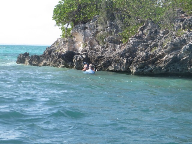 Dan and Al head over to search under the ledge of this tiny rocky cay.