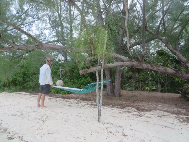 Al inspects a homemade hammock. Notice how the low lying tree branch is supported by the forked branch in the sand. All of which is partially supporting the hammock.