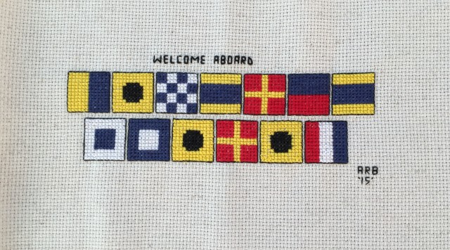 "Anne, on Traveling Soul, this personalized cross stitch. The signal flags spell ""Kindred Spirit. I cannot wait to frame and hang it. I am still speechless - the generosity and thoughtfulness of fellow cruisers is amazing."