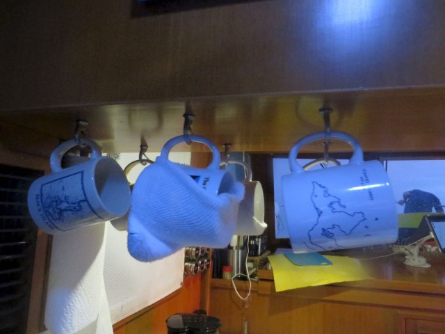 Things were rocking and rolling in the cabin, so I slipped an old sock over the middle mugs to keep them from crashing and banging.
