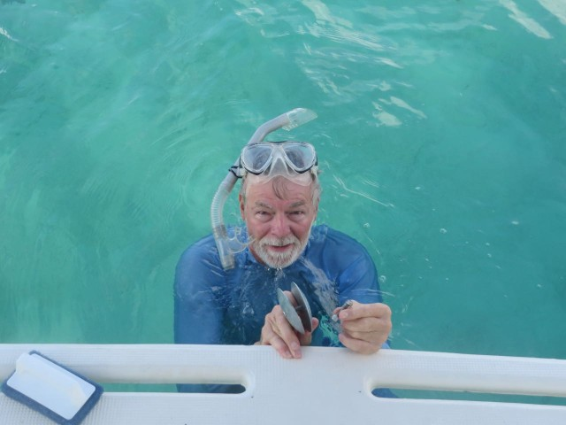 "On one trip, we took the ""big boat"" out of the harbor instead of the dinghy. Anchored and swam off the boat just to relax and play. AL also took the opportunity to replace the zincs on the rudder. An easy job when you can see so clearly under the water."