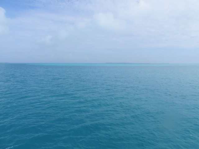 Changes in the color of the water - the paler blue .out there is a very shallow area