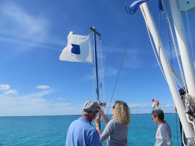 The S flag (S for shortening?) was hoisted to signal that the course has been shortened to end at start instead of including a final leg back to the mark near Johnny's Cay. Of course, the horn was sounded and David also informed the boats on the VHF radio.