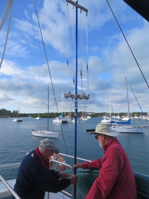 Paul and Al are attaching the race flag staff system to our flybridge.