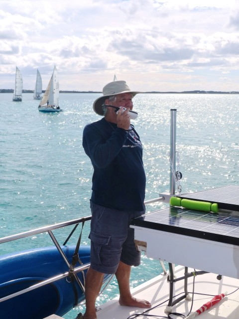 David speaks to the racing boats on the VHF radio.
