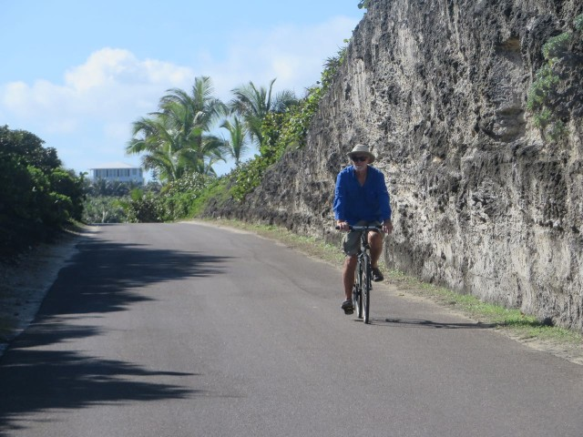 Biking along on a road cut out of the rock.