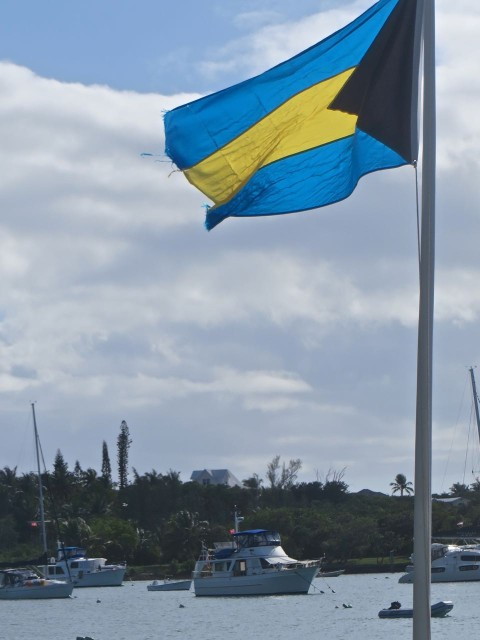 There's Kindred Spirit on her mooring, with the Bahamas flag flying in the foreground.
