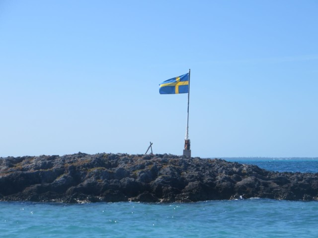 Sure looks like the Swedish flag to me. Perhaps Magnus and Charlotte on Swede Dreams staked a claim?