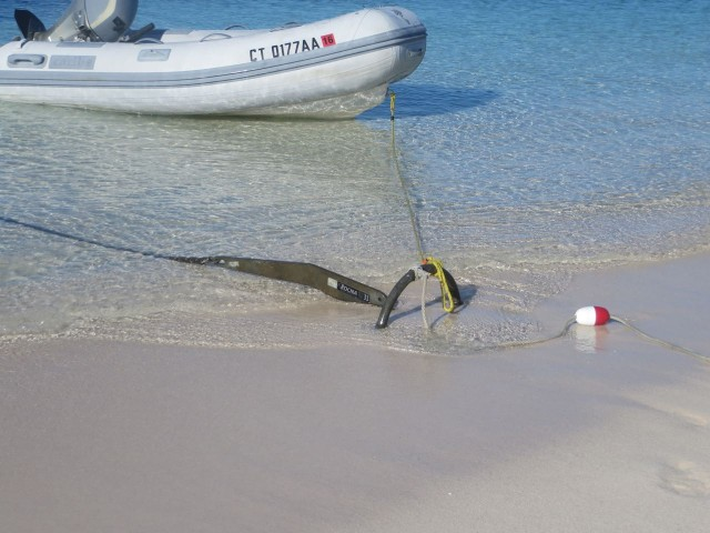 A dinghy, a Rocna, and a float on the sand. Not something we will see very often.