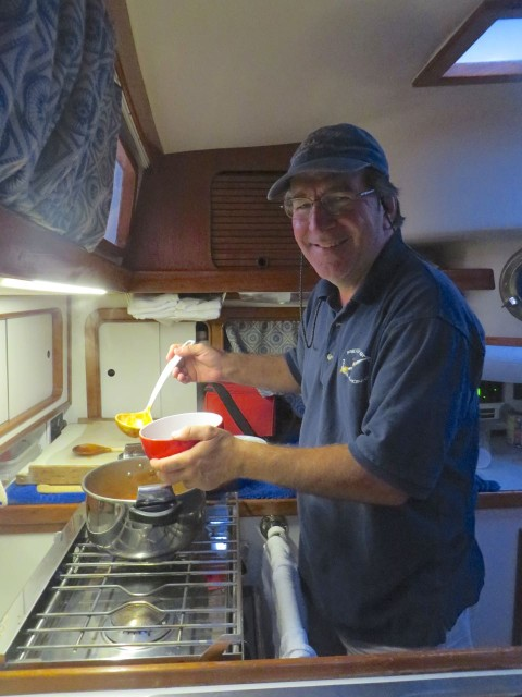 The chef at work in his galley, serving up the A2B chili special.