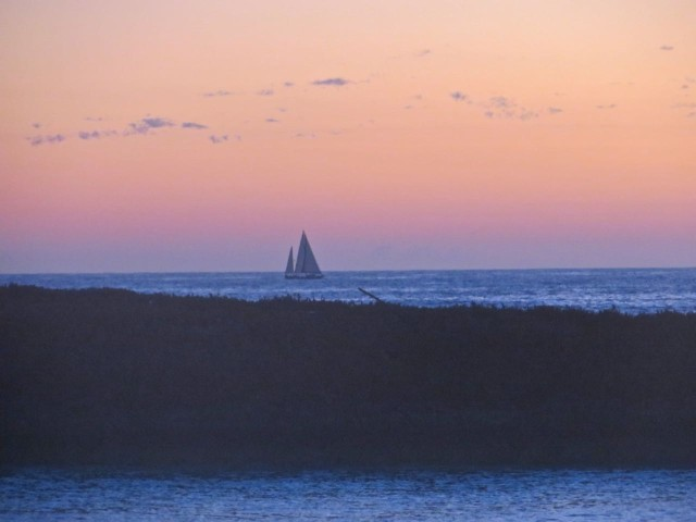 I got up before the sun arose to greet the dawn. Froth flybridge, I was high enough to photographed this sailboat passing Lynyard Cay on the Atlantic Ocean side.