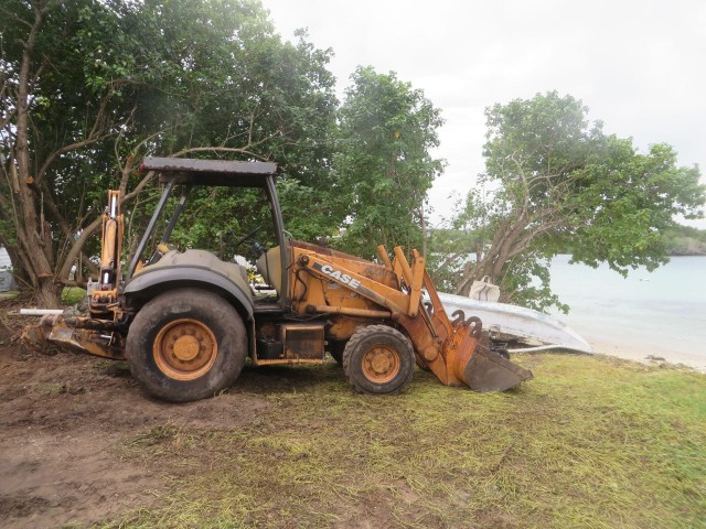 "There was only one way to get this digger to the lot. Wait until low tide and drive it from the nearest ""normal"" road (the word normal is relative) onto the beach, on the beach until you reach John and Carol's lot."