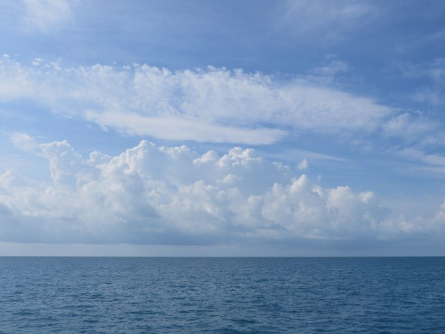 Blue water, blue sky, white clouds.