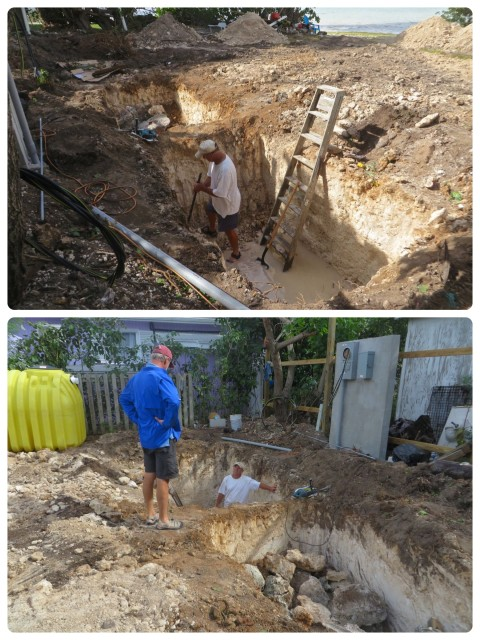 Al chatting with John (in septic tank hole). The digger dug the two holes for the septic tank,