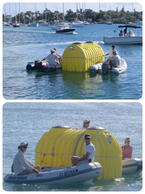 With a dinghy on each side of the tank, it wass guided out of the Hope Town harbor, and out to the outer harbor to John and Carol's lot.
