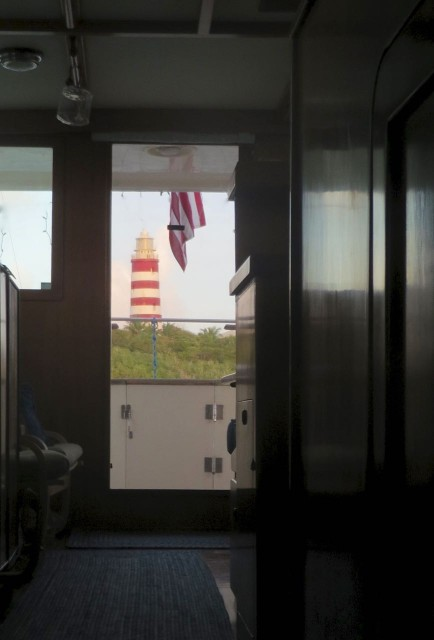Always present - our view of the lighthouse from our cabin, out through the salon door.