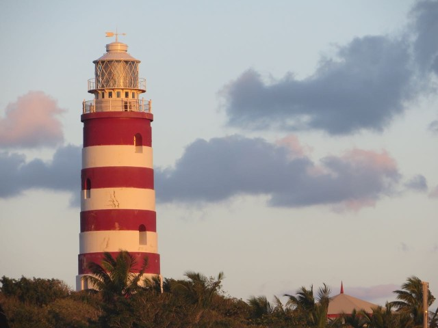 The beginning of a sunset glow around the lighthouse.