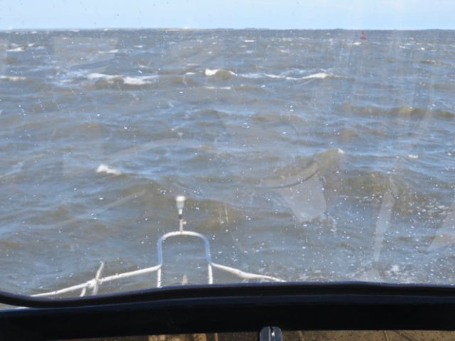 "An attempted photo of our vigorous ride up the Cape Fear River. We were on the flybridge – photo taken through the closed plastic. I is easy to see how this river was named. In conditions worse than this, ""fear"" could be the word of the day."