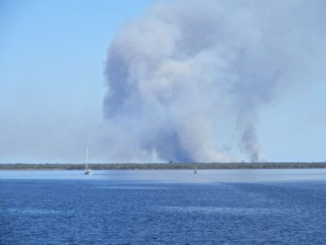 We watched this smoke billowing up for quite a distance as we came through he Alligator River . Never did find out the cause.