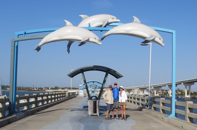 We don't see many docks that are decorated like this. The dolphins are soaring over Dan, Al, and Marcia.