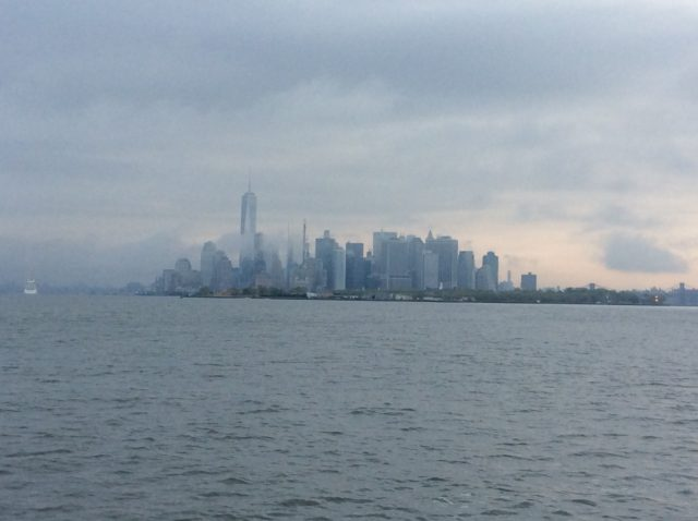 Battery Park, lower Manhattan, appears in the morning mist.