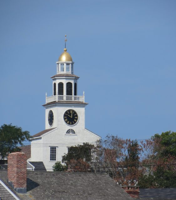The shining steeple of the Congregational Church can be seen from out in the harbor.