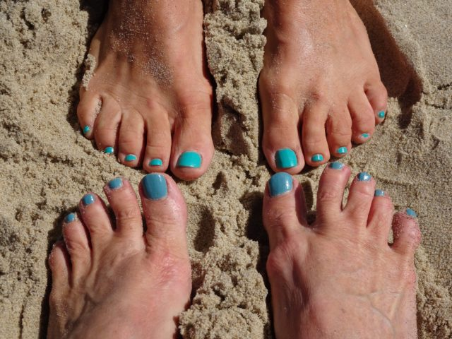 Mary Jo and I wiggle our teal toes in the sand.