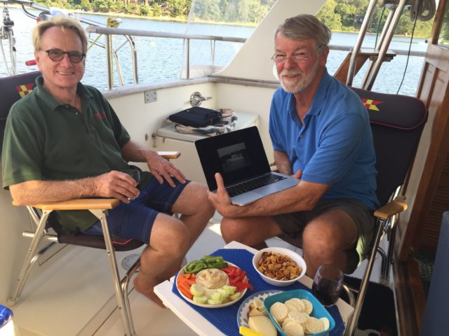 Colin and Al, discussing possible trawler options as we enjoy snacks and drinks.