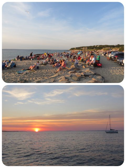 A crowded beach of sunset gazers. We watch the sun set from Kindred Spirit.